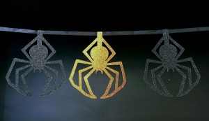 Image: cut out orange and black paper spiders