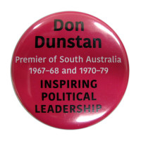Image: Pink badge with black and white writing about Don Dunstan