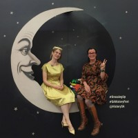 Image: Two women sitting on moon in period costume