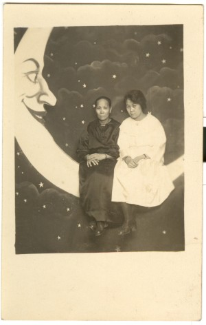 Image: black and white photo of two women on paper moon